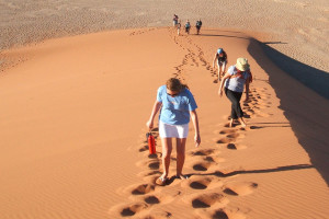 Climbing the sand dunes in Namibia