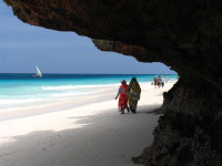 Ladies having a peacful stroll on the  white sand beaches of sunny Zanzibar