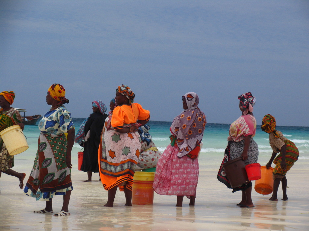 Women waiting for fishermen on Zanzibar Island